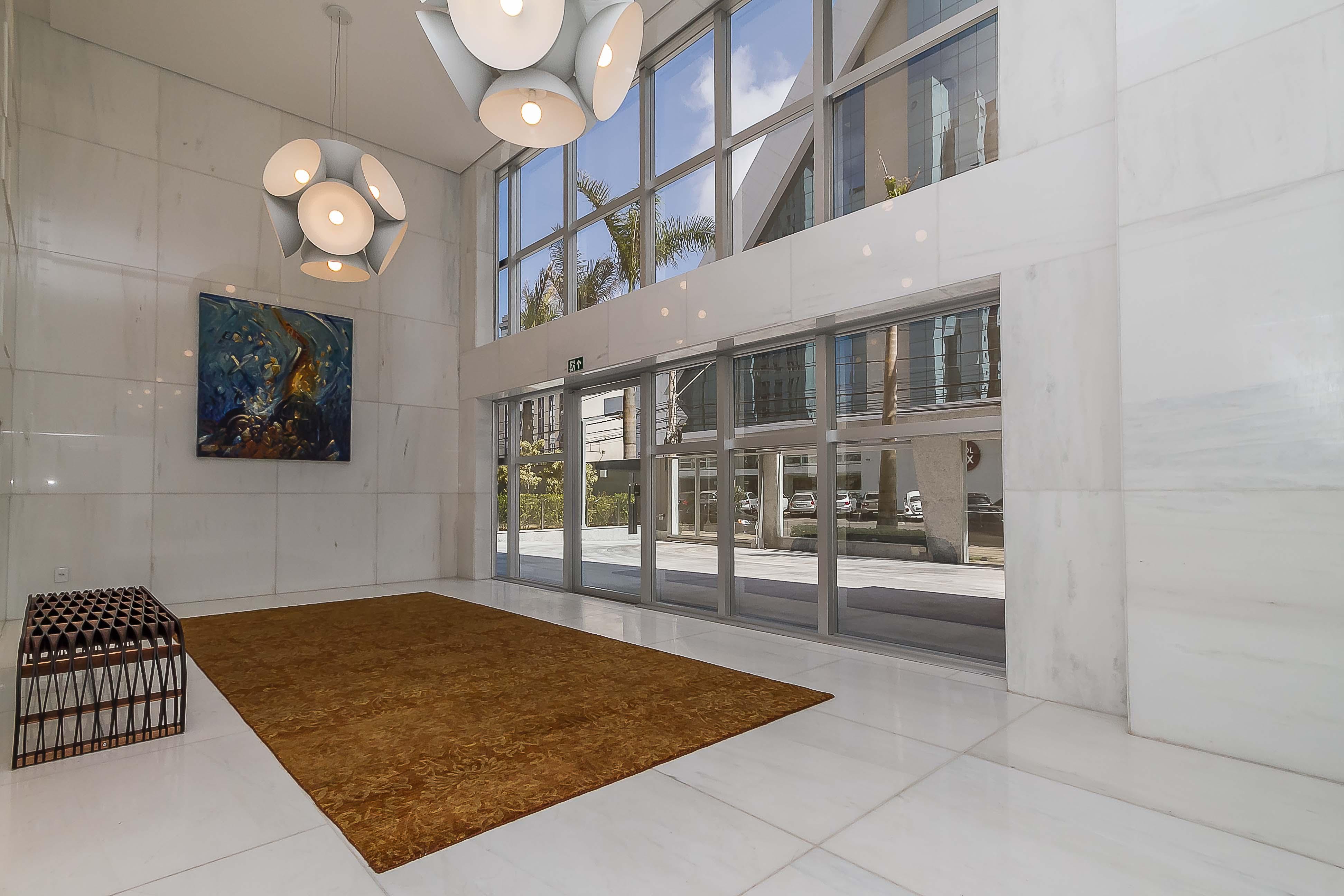 hall de entrada imponente predio de luxo